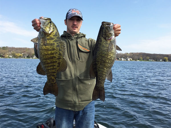 Wisconsin customer with two giant smallmouth bass he caught on Smallie Slayer Widow Maker tubes
